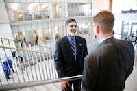 University of Texas at Arlington president Vistasp Karbhari (center) met with people after a  ribbon-cutting for a new Science & Engineering Innovation & Research building on the UTA campus in September.(Tom Fox/Staff Photographer)