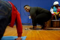 Ebony Smith, founder of Yoga N Da Hood, leds a yoga class to children in DISD's after-school program at B.H. Macon Elementary in Dallas on Wednesday, April 3, 2019. (Rose Baca/Staff Photographer)