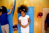 Aiysia Knox, a second-grader in DISD's after-school program, does yoga led by Ebony Smith, founder of Yoga N Da Hood, at B.H. Macon Elementary in Dallas on Wednesday, April 3, 2019.(Rose Baca/Staff Photographer)