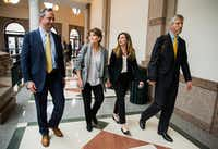Margo Williams and her daughter, Eve Wiley,  walked with their advisers, Kris Heckmann (left) and Justin Keener, after testifying before the Senate Criminal Justice Committee on Wednesday in Austin.(Ashley Landis/Staff Photographer)
