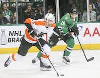 Philadelphia Flyers defenseman Shayne Gostisbehere (53) looks to pass against Dallas Stars center Tyler Pitlick (18) during an NHL hockey game at American Airlines Center in Dallas on Tuesday, April 2, 2019. (Shaban Athuman/Staff Photographer)