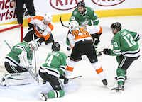 Philadelphia Flyers left wing James van Riemsdyk (25) shoots as Dallas Stars goaltender Anton Khudobin (35) makes a save during the second period of an NHL hockey game at American Airlines Center in Dallas on Tuesday, April 2, 2019. (Shaban Athuman/Staff Photographer)