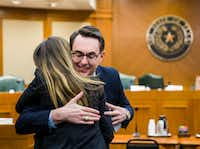 Eve Wiley (left) received a hug from  Justin Wood, director of the Senate Criminal Justice Committee, before her Senate testimony.. Wiley and her mother, Margo Williams, along with Texas Senator Joan Huffman, are trying to pass SB 1259, which would make it a state jail felony for a health care provider to implant human reproductive material from an unauthorized source without consent of the patient. (Ashley Landis/Staff Photographer)