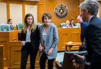 Eve Wiley (left) and her mother, Margo Williams (center), testified  before the Senate Criminal Justice Committee on Wednesday  in Austin. They, with state Sen. Joan Huffman, are trying to pass SB 1259, which would make it a state jail felony for a health care provider to implant human reproductive material from an unauthorized source without consent of the patient. At right are Wiley's advisers Kris Heckmann and Justin Keener of Granite Public Affairs.(Ashley Landis/Staff Photographer)