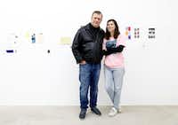 Artist Michelle Rawlings poses with her father, Dallas Mayor Mike Rawlings in front of her <i>Untitled</i>&nbsp;mixed media mural at a 2018 exhibition at AndNow Gallery in Dallas.&nbsp;(Tom Fox/Staff Photographer)