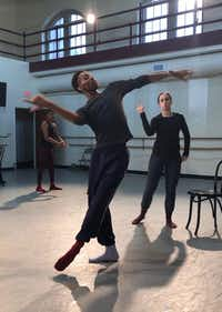 My'Kal Stromile demonstrates choreography for members of DBDT: Encore! The troupe is premiering his new work, <i>Mirror of the Effigy</i>.(Nycole Ray)