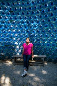 Leslie Moody Castro, who splits her time between Texas and Mexico, poses in a structure made of recovered water bottles in the community space Huerto Roma Verde in the Roma Norte neighborhood of Mexico City.(Brian Harkin/Special Contributor)