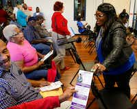 Council candidate Yolanda Faye Williams visits with voters at a candidate forum held by the Community Watch Group of Bruton Terrance and Hillside Oaks Crime Watch at Pleasant Oaks Recreation Center in Dallas.(Brian Elledge/Staff Photographer)