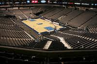 From Ice to Wood: the American Airlines Center changeover from Dallas Stars game to Dallas Mavericks game in the same day, Saturday, Jan. 28, 2006.  This was the first time in AAC history to turn around the Center for two games.(Tom Fox/Staff Photographer)