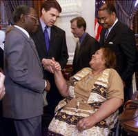 Then-Texas Gov. Rick Perry, second from left, shakes the hand of Stella Byrd, mother of James Byrd Jr., the East Texas black man who was dragged to his death from a pickup truck in 1998 by three white men, following the signing of the James Byrd Jr. Hate Crimes Act at the Capitol in Austin, Texas, in May 2001. Gov. Perry signed the bill into law which strengthens the penalties for offenses against minorities, gays and others.(File Photo/The Associated Press)