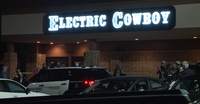 Fort Worth police at the scene where a man exchanged gunfire with a security officer at the Electric Cowboy club early the morning of Sunday, April 7, 2019.(Metro Video)
