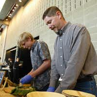 Chris Hughes from Broken Arrow Ranch prepares summer venison sausage samples for the Meet the Makers tasting at Moody Performance Hall, assisted by son Garrett, third-generation of the Ingram ranch family.(Kim Pierce/Special Contributor)