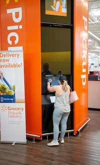 Mackenzie McDaniel of Keller picks up a pair of packages at a North Richland Hills Walmart on April 5, 2019.(Robert W. Hart/Special Contributor)