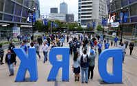 Dallas Mavericks fans pose for photos in the DIRK sign outside American Airlines Center in Dallas on April 3, 2019, before the Mavs played the Minnesota Timberwolves.(Tom Fox/Staff Photographer)