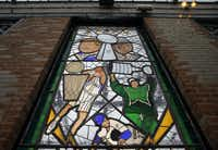 Dallas Mavericks Dirk Nowitzki is depicted in a large, outdoor stained-glass window with other Dallas sports legends at Dot's Hop House & Cocktail Courtyard in Deep Ellum in Dallas.(Tom Fox/Staff Photographer)