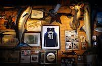 A jersey of Dallas Mavericks Dirk Nowitzki hangs between a pair of mounted swordfish at St. Pete's Dancing Marlin in Deep Ellum in Dallas.(Tom Fox/Staff Photographer)