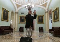 Rep. Pete Sessions waved to reporters as he departed the U.S. Capitol on Dec. 22, 2018.(Alex Edelman/Getty Images)