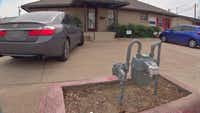This natural gas meter stands right by an office parking lot in Plano, a few feet from the road. Atmos Energy, which owns the meter, said it's been working with the gas customer there to move the meter away from the road and closer to the building.(NBC 5 News)