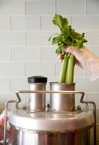 Celery is put inside a juicer at The GEM in Dallas(Rose Baca/Staff Photographer)