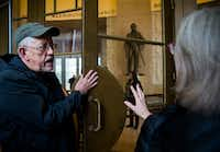 Willis Winters, director of Dallas Parks and Recreation, and Marcel Quimby of Gensler architecture firm talk about the original polish on a door inside the historic Hall of State building on March 1, 2019.(Ashley Landis/Staff Photographer)