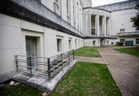 """A door leading to """"negro only"""" restrooms is situated on the back side of the historic Hall of State building. The building, originally built in 1936 ahead of the Texas Centennial Exposition, will soon begin a restoration.(Ashley Landis/Staff Photographer)"""