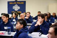 Recruits in Dallas Police Class 365 listen to a lesson about financial peace at the Dallas Police Academy in Dallas.(Tom Fox/Staff Photographer)
