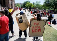Dallas CPS employees Jackie Busby (left) and Dakota Stepney (center) with San Antonio Adult Protective Services employee Andrea Arellano attended the rally for pay raises for state employees Wednesday at the Texas Capitol in Austin.(Dallas Morning News/Vernon Bryant)