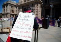Sonia Tillman, a parole officer from Dallas, participated in a rally Wednesday to support pay raise for state employees at the Texas Capitol in Austin.(Dallas Morning News/Vernon Bryant)