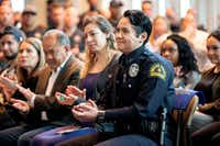 Dallas police officer Crystal Almeida claps after hearing Chief U. Renee Hall, not pictured, commend her service, before receiving the Theodore Roosevelt Police Award on Thursday, April 11, 2019 at the Jack Evans Police Headquarters in Dallas. (Jeffrey McWhorter/Special Contributor)