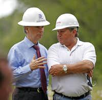 Then-City Manager A.C. Gonzalez talked to  Wayne Kirk (right) as City Council members toured the Texas Horse Park in May 2014. (File Photo/Staff)
