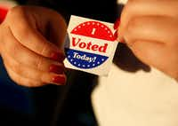"""Maria Garcia, a first-time voter, held an """"I Voted Today!"""" sticker after casting her ballot during early voting at Samuell Grand Recreation Center in Dallas on Oct. 26, 2018.(Rose Baca/Staff Photographer)"""