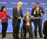 Liberty Mutual Chief Talent and Enterprise Services Officer Melanie Foley, Liberty Mutual Insurance Chairman and CEO David H. Long, Texas Governor Greg Abbott and Plano Mayor Harry LaRosiliere, left to right, cut the ribbon during the ceremonial opening of Liberty Mutual's new campus in Plano on Wednesday, November 29, 2017. (Louis DeLuca/The Dallas Morning News)(Louis DeLuca/Staff Photographer)