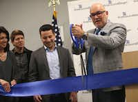 Steve Collis, CEO and president of AmerisourceBergen Corporation, cuts a ceremonial ribbon at AmerisourceBergen's new campus in Carrollton, Texas on April 12, 2019. (Rose Baca/Staff Photographer)(Rose Baca/Staff Photographer)