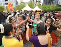 People enjoy music and dancing during the Festival of Joy at Klyde Warren Park in Dallas on March 30. As spring festival season kicks into gear and opportunities for entertainment abound, it may be time to experience life outside your home.(Jason Janik/Special Contributor)