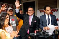 Dallas City Council District 6 candidate Omar Narvaez waved to residents and supporters in late May 2017 after HMK landlord Khraish Khraish (right) announced at a news conference that he had changed his mind and decided to sell homes to their West Dallas tenants for $65,000.(Tom Fox/Staff Photographer)