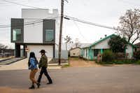 Elizabeth Garcia and father Leonardo Garcia walk past new and old homes in their West Dallas neighborhood on Jan. 10, 2019. (Smiley N. Pool/Staff Photographer)