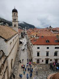 The limestone-paved Stradun, the broad main boulevard of Dubrovnik, is lined with shops and restaurants. The pedestrian street is seen here from atop the city walls.(Travis Pinson/Special Contributor)