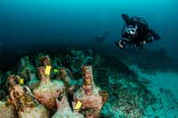 Divers explore the ruins of the ancient Greek shipwreck near the Aegean island of Alonissos, Greece. (Y. Issaris/Agence France-Presse/Getty Images)