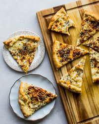 This white pizza is topped with Everything But the Bagel Sesame Seasoning Blend from Trader Joe's.(Rebecca White/Special Contributor)