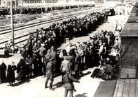 "Many residents of the German village of Kippenheim were ultimately sent to their deaths at the Auschwitz concentration camp in Poland. This photograph shows prisoners arriving at the Nazi camp in 1943 and being sent to either ""the right or the left"" — one direction meaning their life, as it were, would continue, the other direction meaning certain death.(Crux Publishing/Patricia Posner)"
