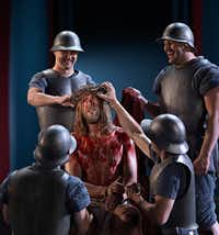 Roman soldiers place the crown of thorns on Jesus' head in the Passion Play in the German town of Oberammergau.(Brigitte Maria Mayer/Passionsspiele Oberammergau)
