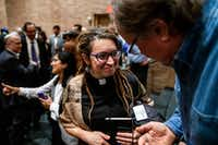 The Rev. Rachel Baughman, senior pastor at Oak Lawn United Methodist Church, speaks with an attendee following a community service of hope and healing at Congregation Shearith Israel on October 28, 2018(Shaban Athuman/Staff Photographer)