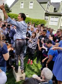 Beto O'Rourke stumps on a wooden box at a backyard house party in Alexandria, Va., on April 17, 2019.(Todd J. Gillman/staff)