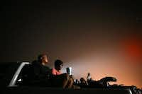 As stars light the sky, Ken Bartlette and his wife, Tammie Bartlette, from Dallas, watched the movie<i> Transformers: Revenge of the Fallen </i>from the back of their truck at the Galaxy Drive-In in Ennis, Texas on June 26, 2009.&nbsp;(Staff/The Dallas Morning News)