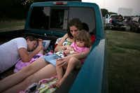 Danny Kinnard sleeps as his wife, Katy Kinnard, and daughter Gracie Kinnard, 3, from Waxahachie, waited for the sun to go down to watch a double feature at the Galaxy Drive-In in Ennis in 2009.(Staff/The Dallas Morning News)