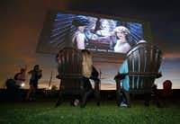"""Tina and Art Lira of Lewisville settle in to watch the """"Coming Attractions"""" reel at the Coyote Drive-In in Lewisville in 2016.(Louis DeLuca/Staff Photographer)"""