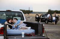 Rachel Leigh Marek and Andrew Shepherd  wait for their movie to start at the Galaxy Drive-In in Ennis on Aug. 6, 2014.(Brad Loper/Staff Photographer)