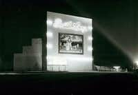 """The South Loop Drive-in, located along East Ledbetter Drive close to Interstate 45, opened in 1950.  The original screen, destroyed by a windstorm in 1956, featured a mural of Snow White and the Seven Dwarfs.  The theater was lost by 1968.&nbsp;(<p><span style=""""font-size: 1em; background-color: transparent;"""">L. """"Bub"""" Thompson Photography</span><br></p><p></p>/Courtesy)"""