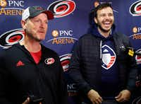 Tom Dundon, left, majority owner of the Carolina Hurricanes, and Charlie Ebersol, co-founder and CEO of the Alliance of American Football, talked with the media in February in Raleigh, N.C., when the Dallas billionaire rescued the struggling league.&nbsp;(Chris Seward/The Associated Press<br>)