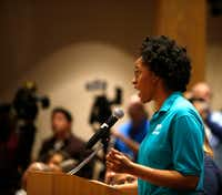 """Brianna Brown, deputy director of the Texas Organizing Project, spoke in support of the """"A Welcoming Communities"""" resolution during a meeting at the Dallas County Commissioners Court on Feb. 7, 2017.(Rose Baca/Staff Photographer)"""